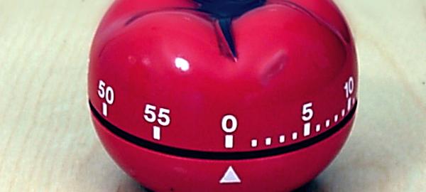Imagen de un temporizador en forma de tomate, método Pomodoro.